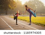mom and daughter on the morning ... | Shutterstock . vector #1185974305