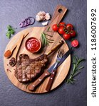 beef steak with spices and... | Shutterstock . vector #1186007692