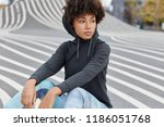 thoughtful younsgter dressed in ... | Shutterstock . vector #1186051768