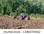 after plowing the field the...   Shutterstock . vector #1186070062