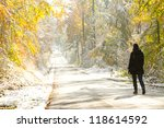 Woman Walking In Colorful Snowy ...
