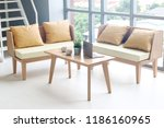 yellow wooden sofa put near... | Shutterstock . vector #1186160965