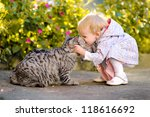 Stock photo portrait of a little girl with a cat 118616692