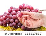 Hand with a grape. Isolated on white background - stock photo