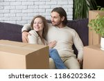 married couple sitting on couch ... | Shutterstock . vector #1186202362
