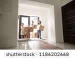 happy family in hallway. young... | Shutterstock . vector #1186202668