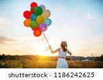 Girl With Colorful Balloons...