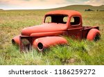 A Rusty  Old Abandoned Red Car...
