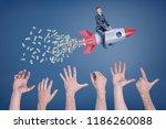 a businessman flies sitting on... | Shutterstock . vector #1186260088