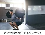workout at gym. sports man... | Shutterstock . vector #1186269925