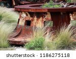 old rusty windlass surrounded... | Shutterstock . vector #1186275118