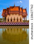 buddhistic pagoda reflected in water in Koh Samui island, Thailand - stock photo