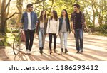 group of students walking... | Shutterstock . vector #1186293412