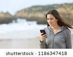 disappointed teen reading phone ... | Shutterstock . vector #1186347418