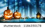 spooky halloween pumpkins in... | Shutterstock . vector #1186350178