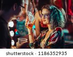 young woman at the festival... | Shutterstock . vector #1186352935