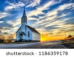 A Lone Wooden Church at Dusk with Sunset Clouds in Kansas American Midwest Prairie