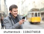 happy man uses a smart phone... | Shutterstock . vector #1186376818