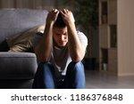 sad man complaints sitting on... | Shutterstock . vector #1186376848