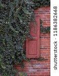 red wooden window shutter of a... | Shutterstock . vector #1186382668