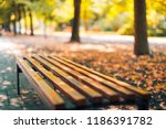 empty bench in the autumnal... | Shutterstock . vector #1186391782