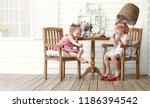 girls playing in a beauty salon | Shutterstock . vector #1186394542