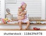 portrait of two happy little... | Shutterstock . vector #1186396978