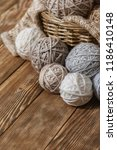 basket with balls of yarn on a... | Shutterstock . vector #1186410148