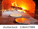 pizza with cheese in the oven... | Shutterstock . vector #1186417888