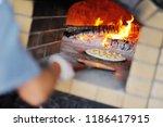 italian focaccia in the oven... | Shutterstock . vector #1186417915