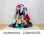 big pile of clothes on the floor | Shutterstock . vector #1186442335