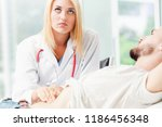 woman doctor is talking and...   Shutterstock . vector #1186456348