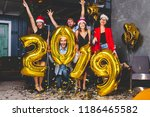 celebrating new year party.... | Shutterstock . vector #1186465582