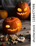 happy halloween pumpkins with... | Shutterstock . vector #1186477498