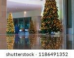 illuminated christmas trees in... | Shutterstock . vector #1186491352