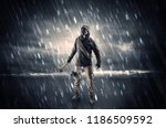 terrorist in a stormy space... | Shutterstock . vector #1186509592