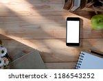 mockup smartphone on workspace... | Shutterstock . vector #1186543252