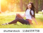 young woman relax in the park... | Shutterstock . vector #1186559758