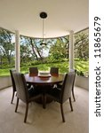 Round dining room with garden view - stock photo