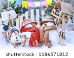 family of snowmen on skis and... | Shutterstock . vector #1186571812