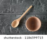 wooden bowl and spoon hand on... | Shutterstock . vector #1186599715