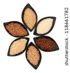 Small photo of Selection of demerara, granulated, molasses, muscovado, crystal and light brown sugar in black leaf shaped dishes over white background.