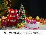 christmas fir tree and gift... | Shutterstock . vector #1186640632