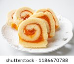 swiss roll filled with orange... | Shutterstock . vector #1186670788