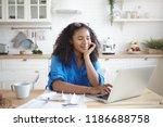 indoor shot of happy young afro ... | Shutterstock . vector #1186688758
