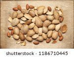 peeled and unpeeled almonds... | Shutterstock . vector #1186710445