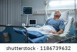in the hospital senior patient... | Shutterstock . vector #1186739632