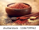 Stock photo red black and white quinoa grains in a wooden spoon healthy food in a bowl seeds of white red 1186739962