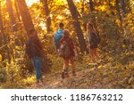 group of four friends hiking... | Shutterstock . vector #1186763212