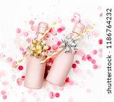 pale pink mini bottles of...   Shutterstock . vector #1186764232